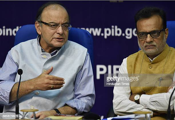 Finance Minister Arun Jaitley with Revenue Secretary Hasmukh Adhiya addresses a press conference a day after Goods and Services Tax bill passed in...