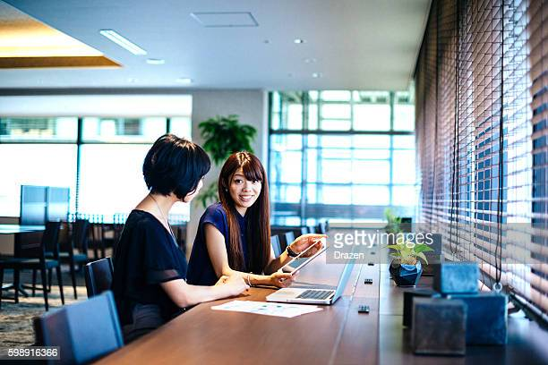 Finance minister assistants in Japan analyzing financial situation