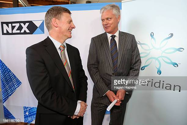 Finance minister Bill English and Meridian Energy CEO Mark Binns speak soon after the listing of Meridian Energy at NZX on October 29, 2013 in...