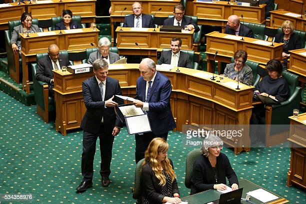 Finance Minister Bill English delivers copies of his budget to MPs with the help of Economic Development Minister Steven Joyce during the 2016 budget...