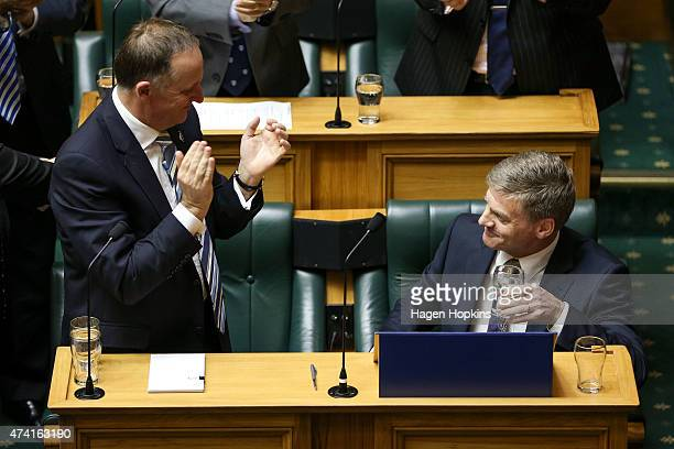 Finance Minister Bill English is applauded by Prime Minister John Key at the end of his speech during the 2015 budget presentation at Parliament...