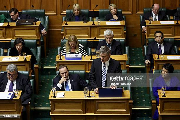 Finance Minister Bill English speaks while Prime Minister John Key looks on during the 2014 budget presentation at Parliament on May 15 2014 in...