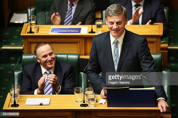 Finance Minister Bill English speaks while Prime Minister John Key looks on during the 2016 budget presentation at Parliament on May 26 2016 in...