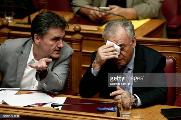 Finance minister Euclid Tsakalotos with Vice president Yannis Dragasakis during a session in the plenary of the Greek Parliament on the draft law...