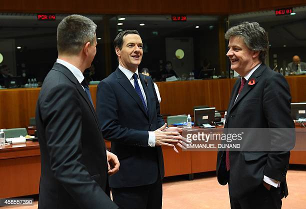 UK Finance Minister George Osborne talks to European Commissioner Financial Stability Financial Services and Capital Markets Union Jonathan Hill and...