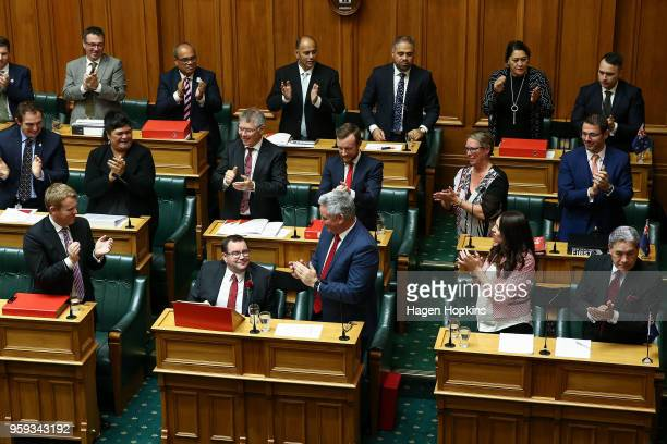 Finance Minister Grant Robertson is applauded by colleagues after his 2018 budget presentation at Parliament on May 17 2018 in Wellington New Zealand...