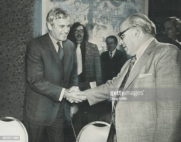 Finance minister John Turner right and William McGregor Canadian Labor Congress vicepresdent shake hands at Toronto meeting yesterday Turner tried...