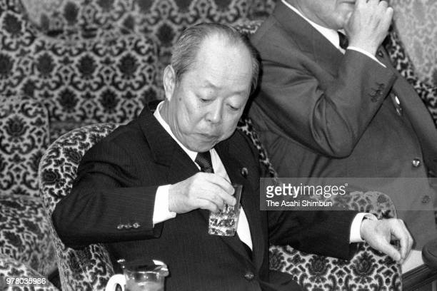 Finance Minister Kiichi Miyazawa drinks water at a Lower House special committee on December 1 1988 in Tokyo Japan