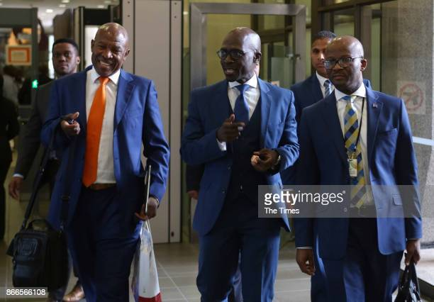 Finance Minister Malusi Gigaba is flanked on his right by Reserve Bank Governor Lesetja Kganyago and on his right by treasury directorgeneral Dondo...