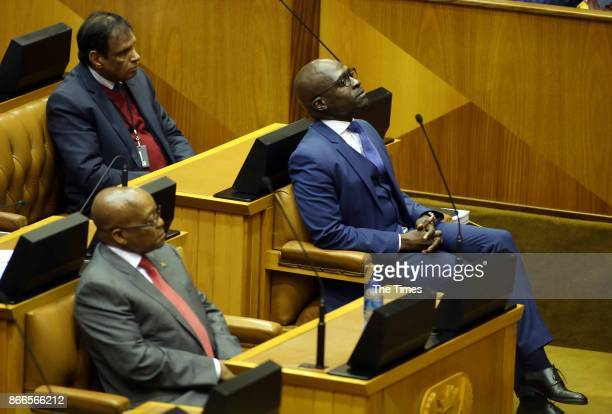 Finance Minister Malusi Gigaba is seen next to President Jacob Zuma during his Mediumterm budget speech in Parliament on October 25 2017 in Cape Town...