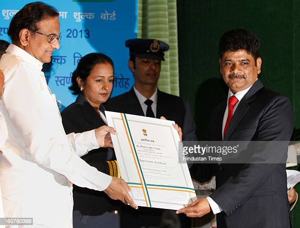 Finance minister P Chidambaram present Presidential awards to Abinash Kumar Sinha, Intelligence Officer, Central Economic Intelligence Bureau at...