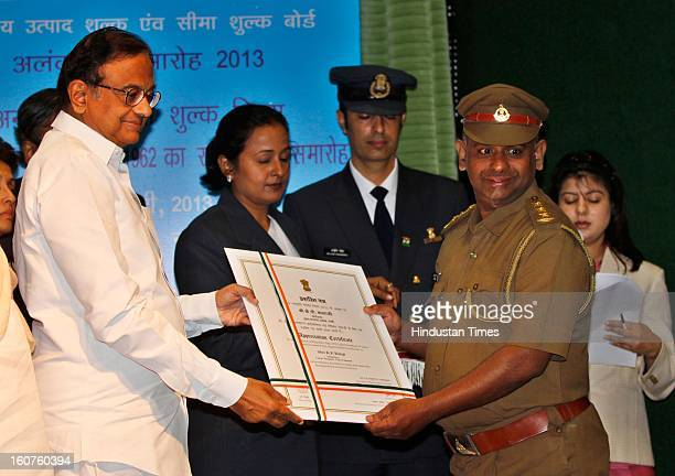 Finance minister P Chidambaram present Presidential awards to KP Balaji, Inspector, Large Taxpayers Unit, Chennai at Manekshaw centre, on February 5,...