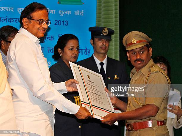 Finance minister P Chidambaram present Presidential awards to M Mallikarjuna, Inspector, Commissionerate of Central Excise, Belgaum at Manekshaw...