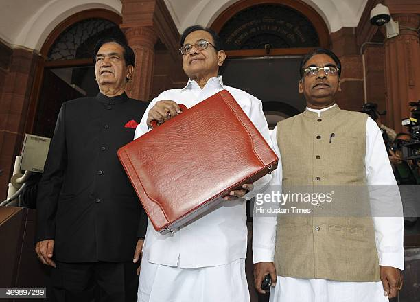Finance Minister P Chidambaram shows a briefcase containing interim budget for the fiscal year 201415 with State Ministers of Finance Namo Narain...