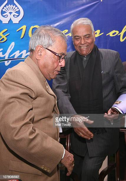 Finance Minister Pranab Mukherjee and senior BJP leader Yashwant Sinha during a function to celebrate 10 years of South Asian Free Media Association...