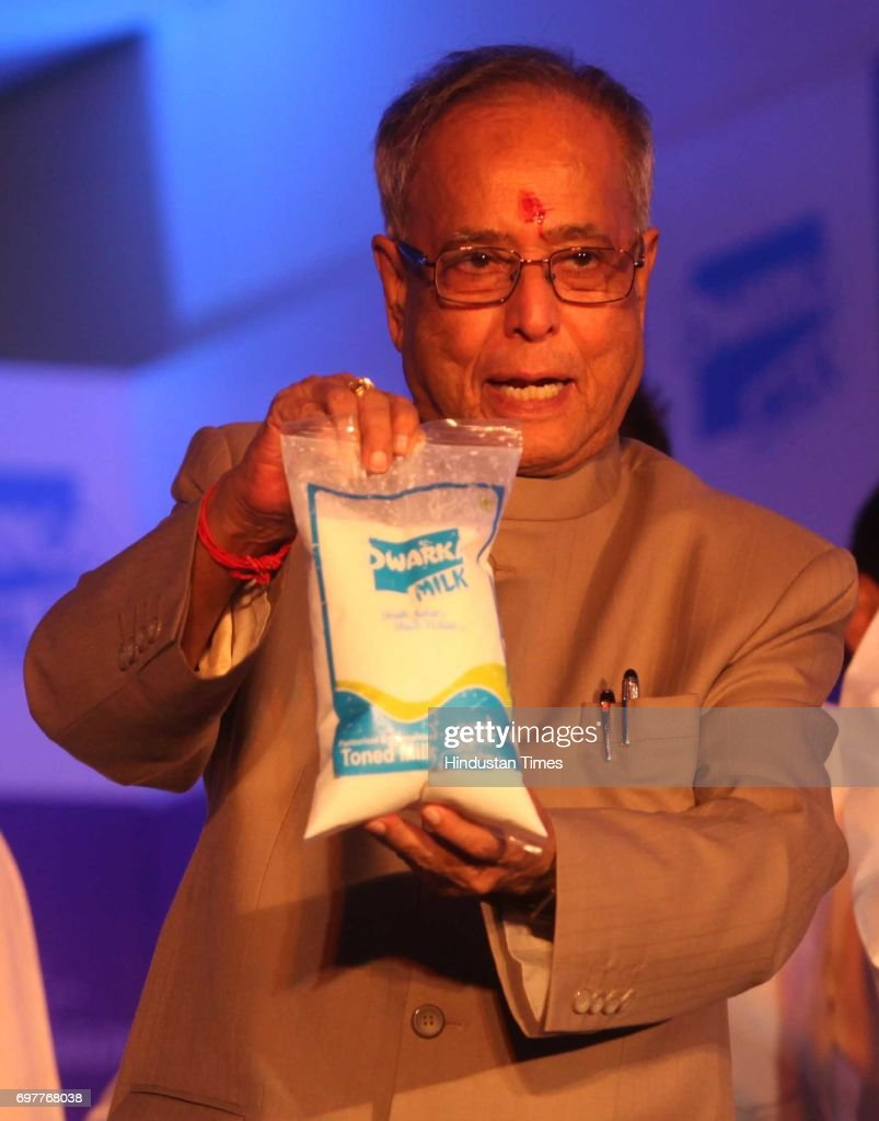 Finance Minister Pranab Mukherjee at launch of Dwarka Milk and hands cattle to a farmer on finance scheme for marginal dairy organised by Dwarka Milk at Vashi on Monday.