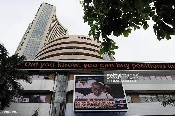 Finance minister Pranab Mukherjee is seen delivering his budget speech in Parliament on the digital broadcast on the facade of the Bombay Stock...