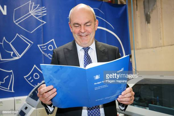 Finance Minister Steven Joyce looks over a copy of his budget speech during the printing of the budget at Printlink on May 23 2017 in Wellington New...