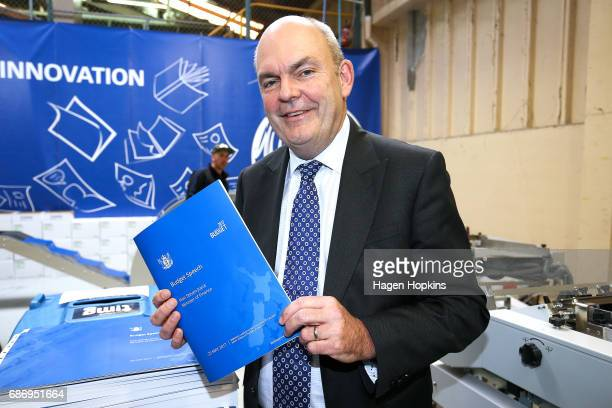Finance Minister Steven Joyce poses with a copy of his budget speech during the printing of the budget at Printlink on May 23 2017 in Wellington New...
