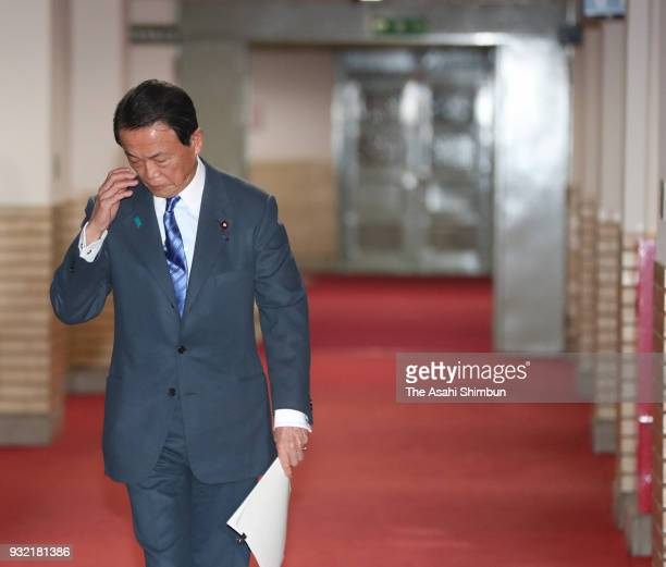 Finance Minister Taro Aso leaves his office to questions about altered documents at the ministry on March 12 2018 in Tokyo Japan The Finance Ministry...