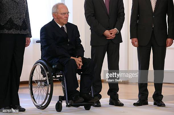 Finance Minister Wolfgang Schaeuble attends a ceremony in which German President Joachim Gauck appointed the new German government cabinet on...