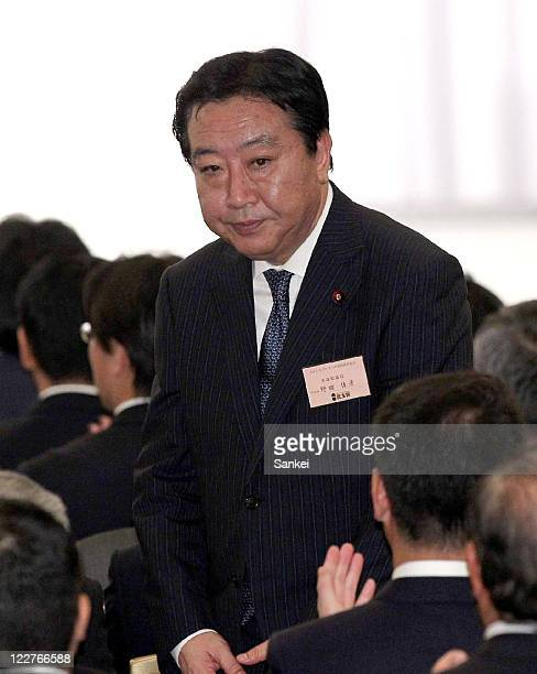 Finance Minister Yoshihiko Noda bows as he was elected the new Democratic Party of Japan president during the DPJ lawmakers general assembly on...