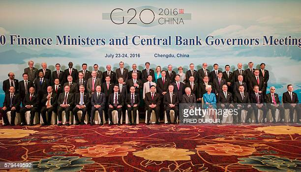 Finance ministers and central bank governors pose for a 'family photo' at the G20 finance ministers meeting in Chengdu in China's Sichuan province on...