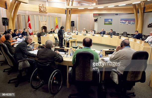 G7 Finance ministers and central bankers watch as an Inuit elder Enaopik Sageatok centre performs a ceremony at the start of talks February 6 in...