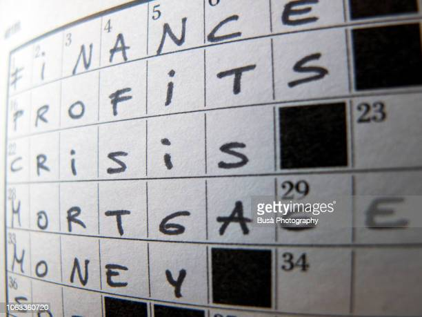 Finance, Profits, Crisis, Mortgage, Money writing on crossword puzzle