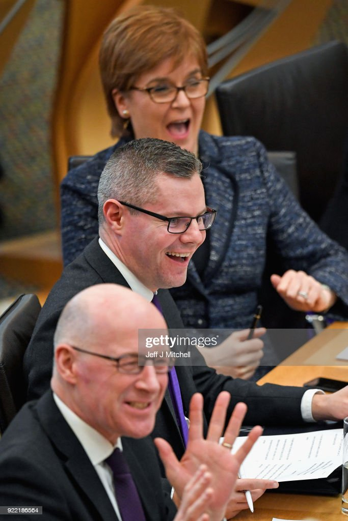 Finance secretary Derek Mackay, First Minister of Scotland Nicola Sturgeon and John Swinney Education Secretary react in the Scottish Parliament during final stage of Scottish Budget on February 21, 2018 in Edinburgh, Scotland. The final debate on the Budget Bill took place ahead of the crucial vote at decision time later today.