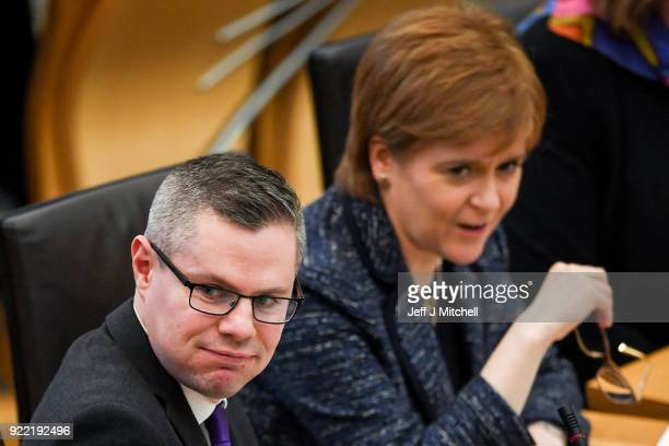 Finance secretary Derek Mackay First Minister of Scotland Nicola Sturgeon react in the Scottish Parliament during final stage of Scottish Budget on...