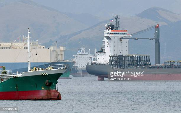 Finance-economy-Philippines-shipping,FEATURE by Mynardo Macaraig This photo taken on March 13, 2009 shows some of the 20 ships anchored at the former...