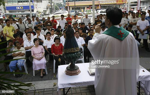 FinanceeconomyPhilippinesshippinglabour by Jason Gutierrez Prospective applicants attend a mass before an icon of the Nuestra Senora De Guia the...