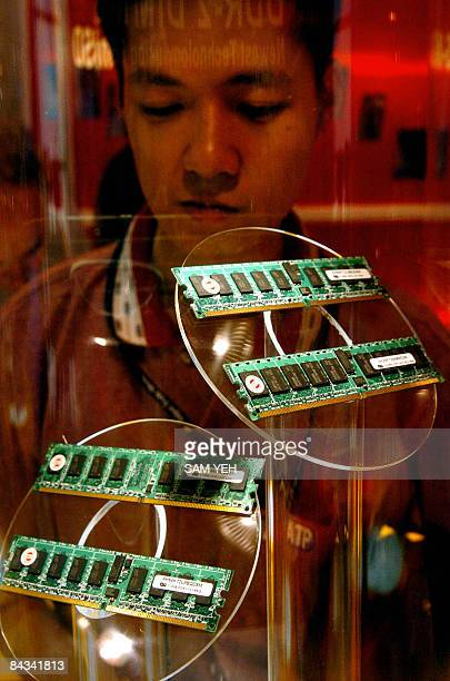 FinanceeconomyTaiwanITDRAMFOCUS by Benjamin Yeh This file photo taken on June 1 2004 shows a visitor looking at a display showing the latest DRAM or...