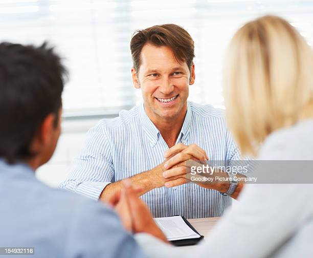 Financial adviser with his clients