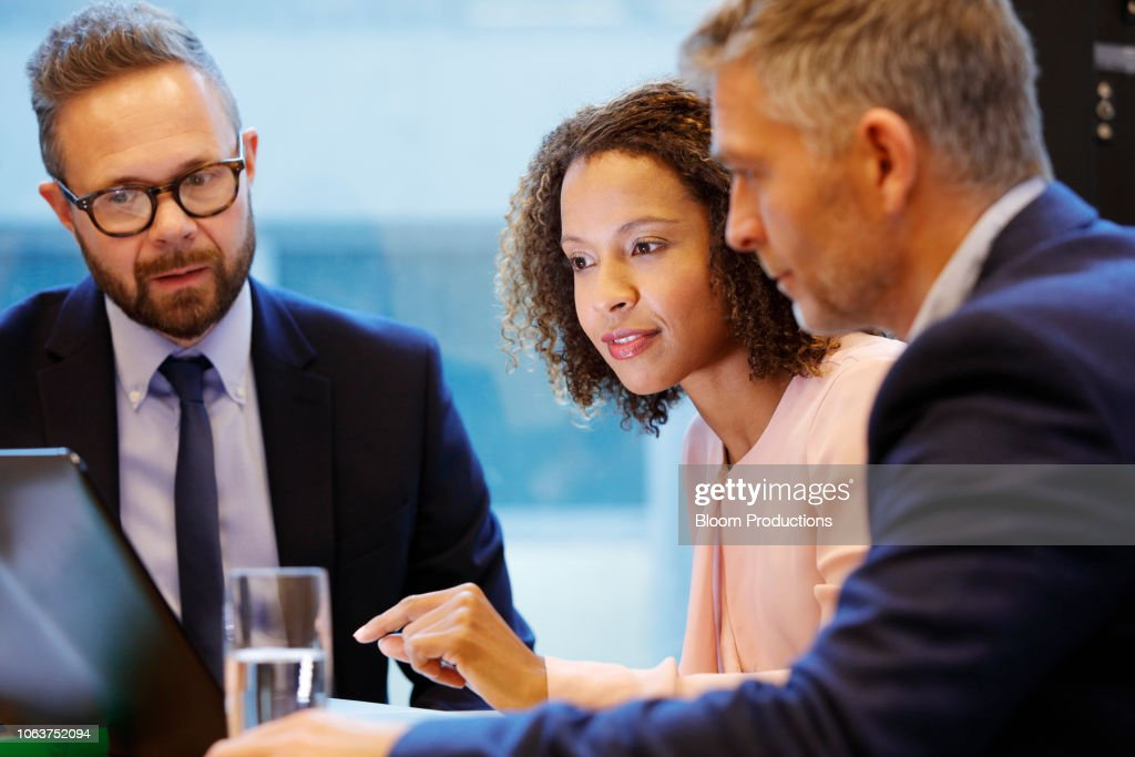 Financial advisior having a meeting with couple : Stock Photo