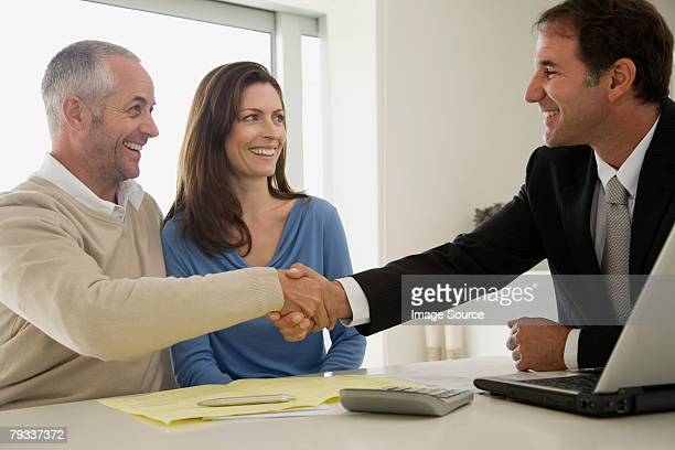 Financial advisor and man shaking hands