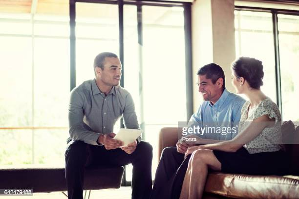 Financial advisor discussing with happy couple