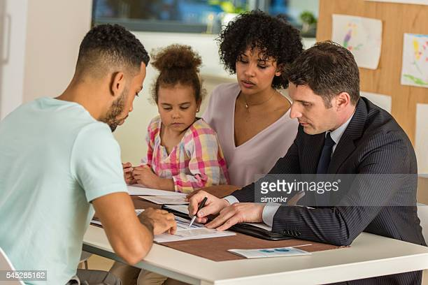 Financial advisor discussing with his clients
