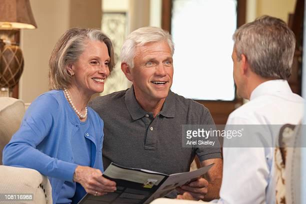 Financial advisor explaining investments to couple