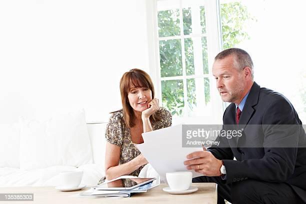 Financial advisor explaining paperwork to customer