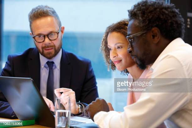 financial advisor having a meeting with clients - bankieren stock pictures, royalty-free photos & images