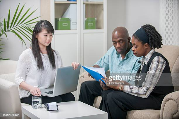 Financial Advisor Helping a Couple Budget