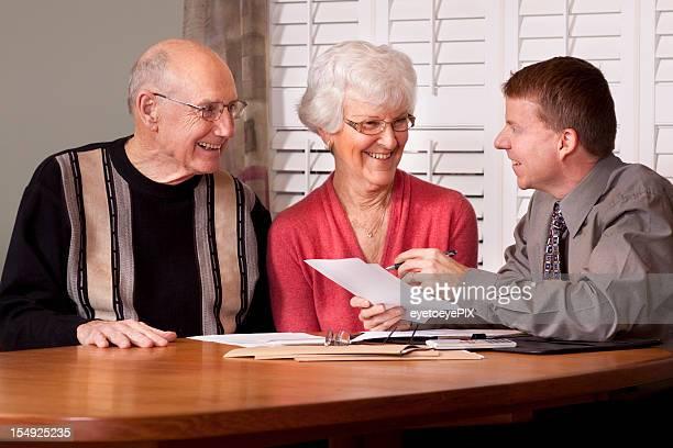 Financial Advisor making plans with Senior Couple