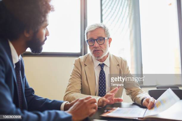 financial advisor meeting in a bank office. - financial advisor stock pictures, royalty-free photos & images