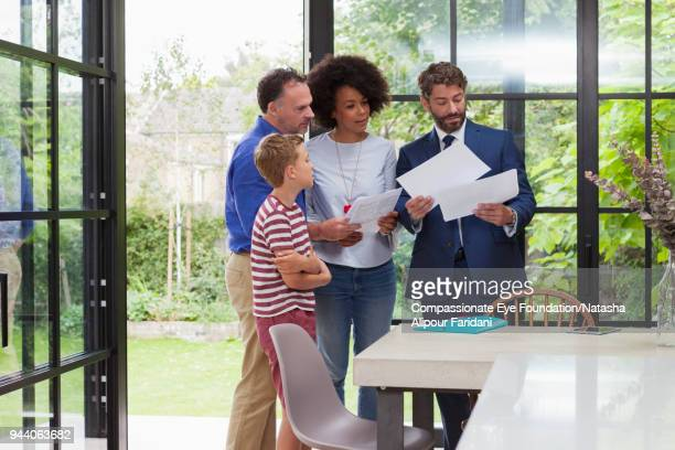 Financial advisor meeting with family in kitchen