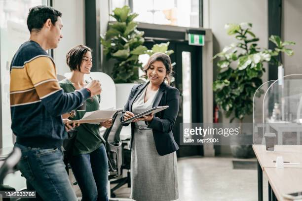 financial advisor  on the meeting with new bank  customers - employee engagement stock pictures, royalty-free photos & images