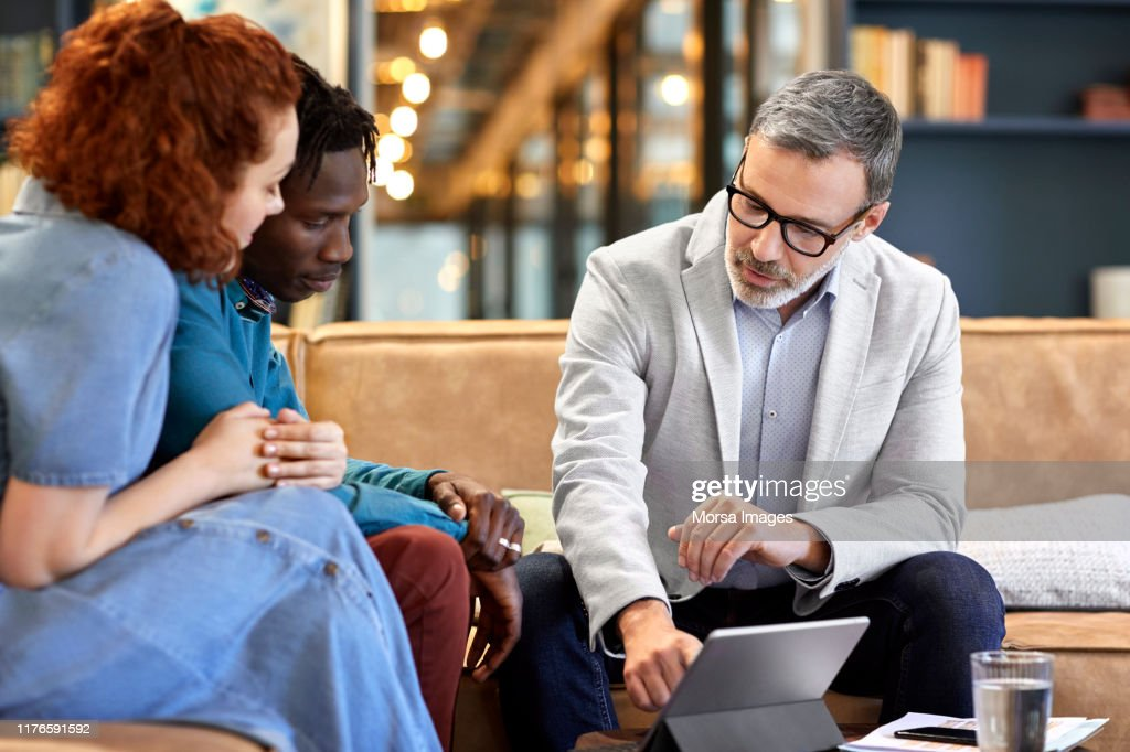 Financial advisor planning with clients at office : Stock Photo
