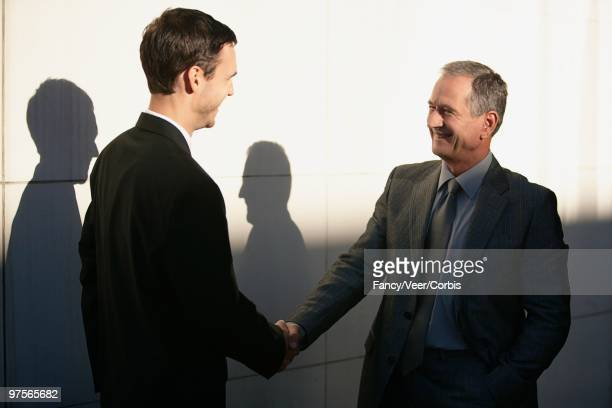 Financial advisor shaking hands with a client