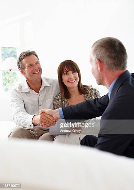 Financial advisor shaking hands with customers